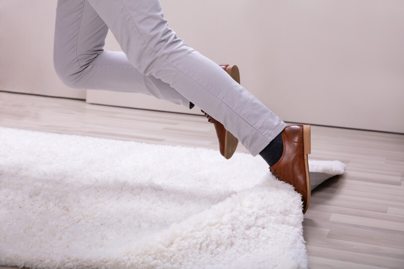 Man trips and falls on carpet