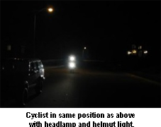 Cyclist with headlight on at night